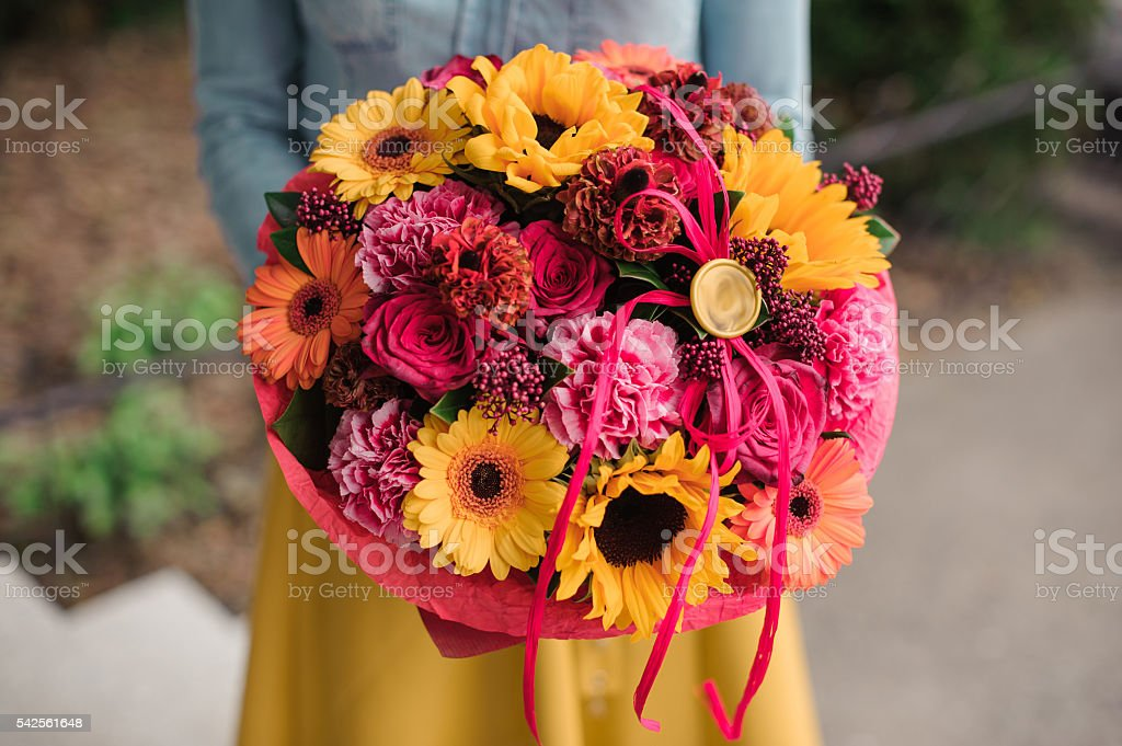 girl holding colorful bouquet with different Gerbera flower stock photo