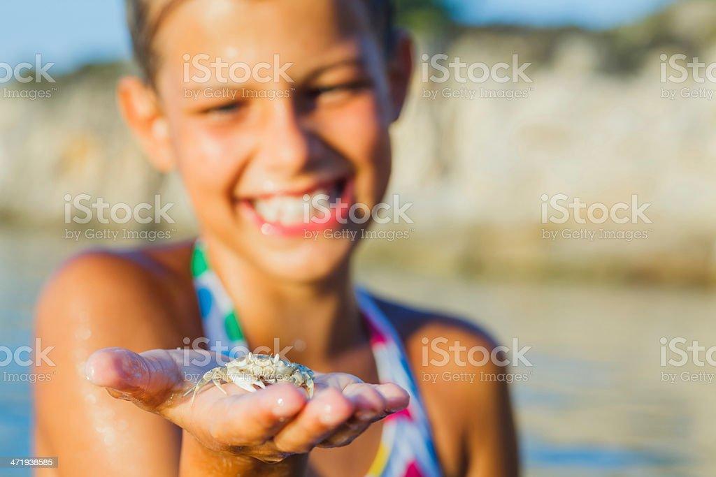 Girl holding crab stock photo
