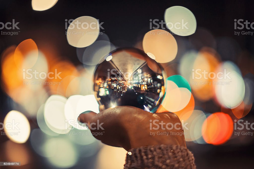 Girl holding crystal ball stock photo