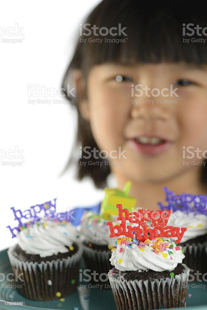 Girl Holding Cupcakes With Birthday Decorations royalty-free stock photo