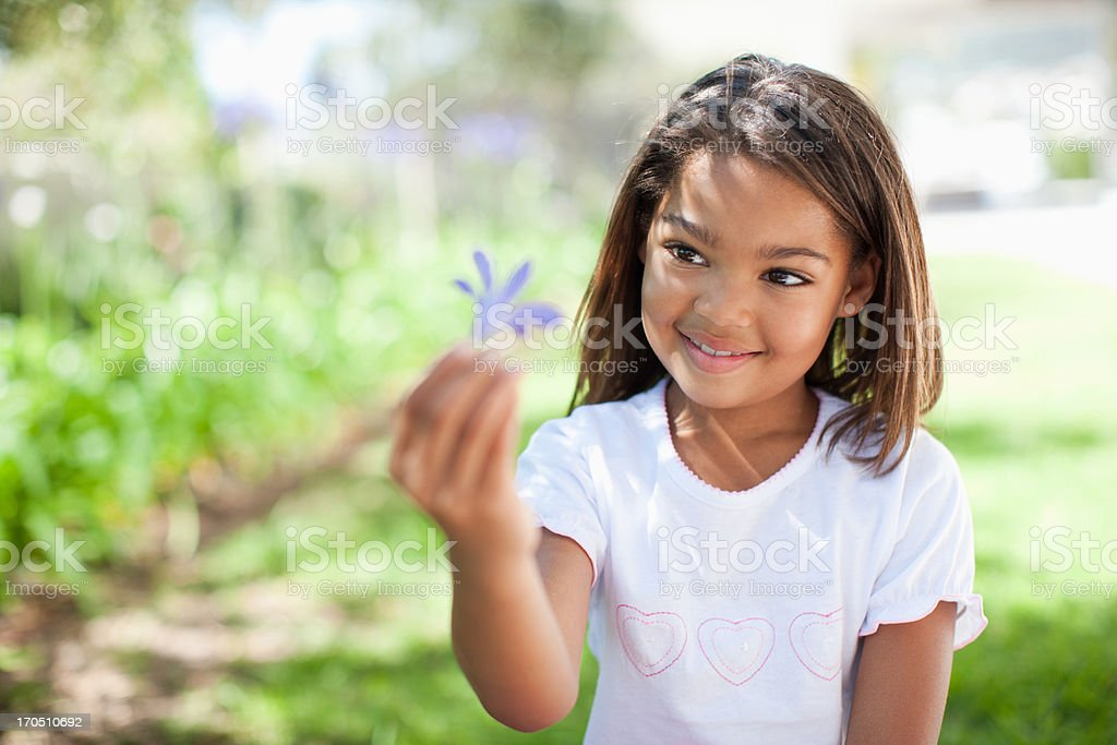 Girl holding flower outdoors royalty-free stock photo