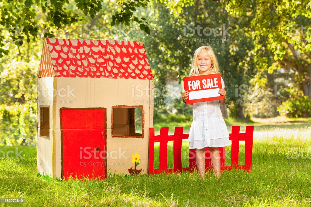 Girl Holding ~For Sale~ Sign stock photo