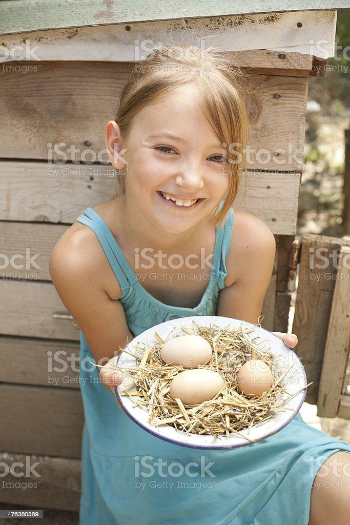girl holding fresh eggs royalty-free stock photo