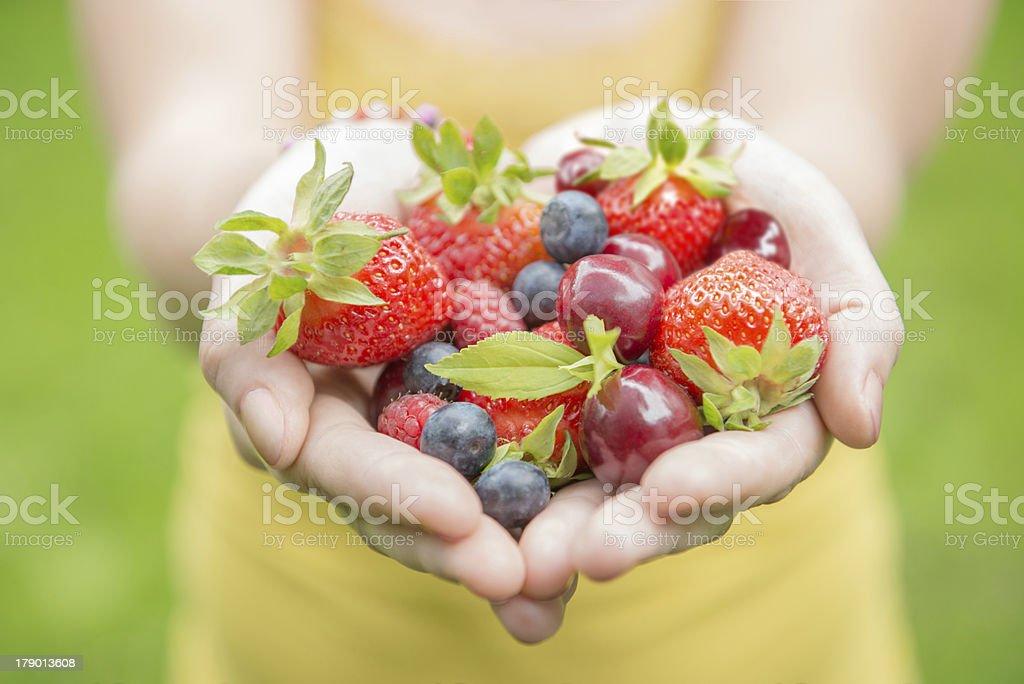 girl holding fruits stock photo