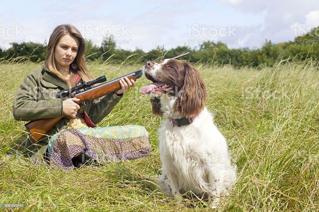 girl holding  gun , hunting with dog stock photo