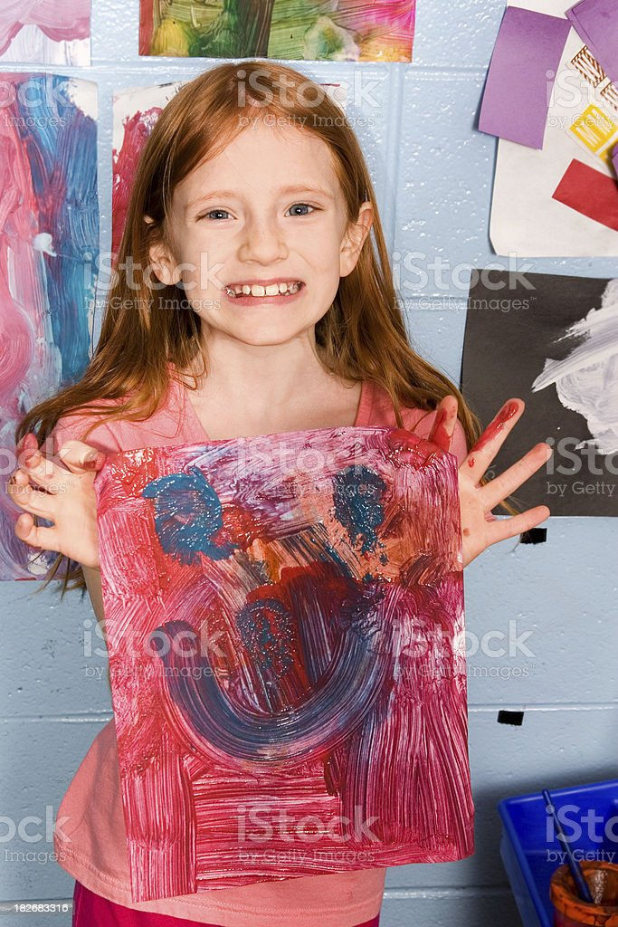 Girl holding happy painting royalty-free stock photo