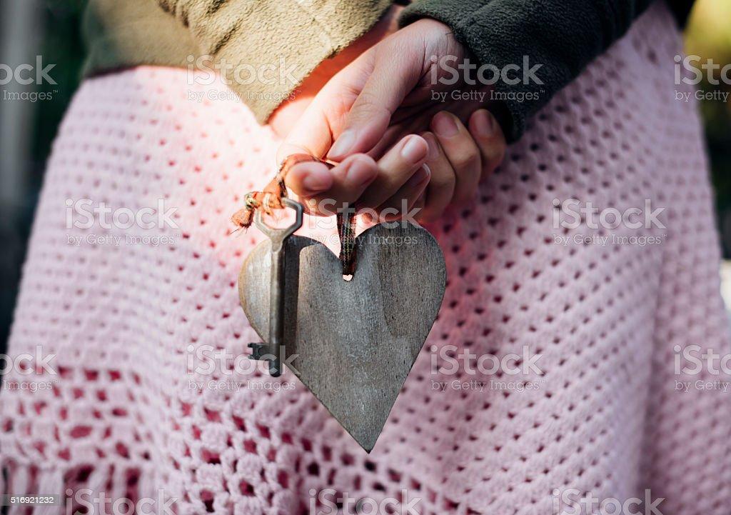 Girl holding heart stock photo