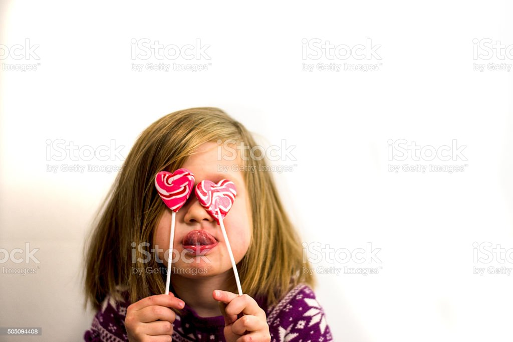 Girl holding Heart shape candy stock photo