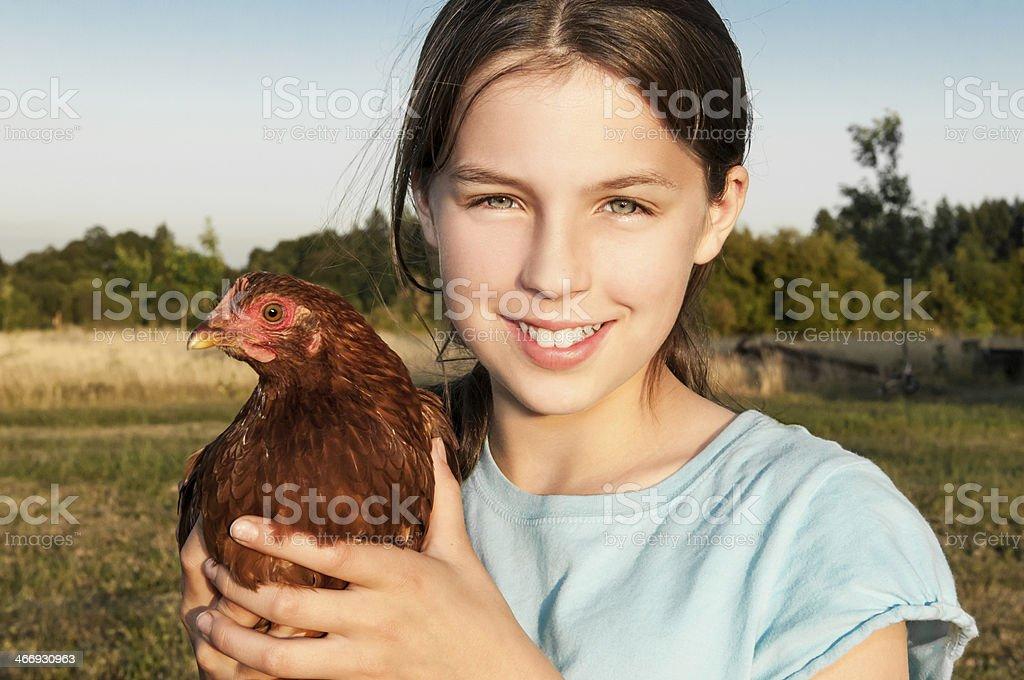 Girl Holding Hen royalty-free stock photo