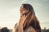 Girl Holding Her Hair Over Her Face Seductively
