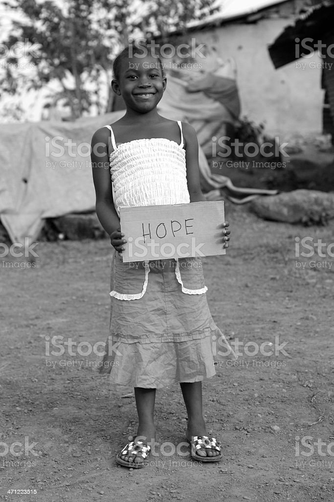 Girl Holding 'Hope' Sign royalty-free stock photo
