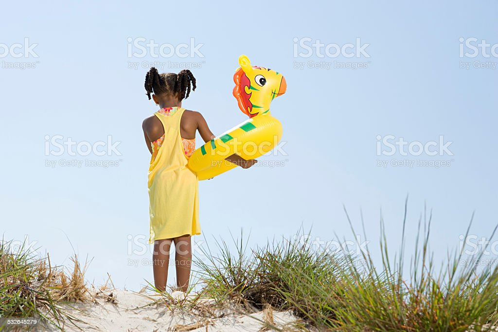 Girl holding inflatable ring stock photo