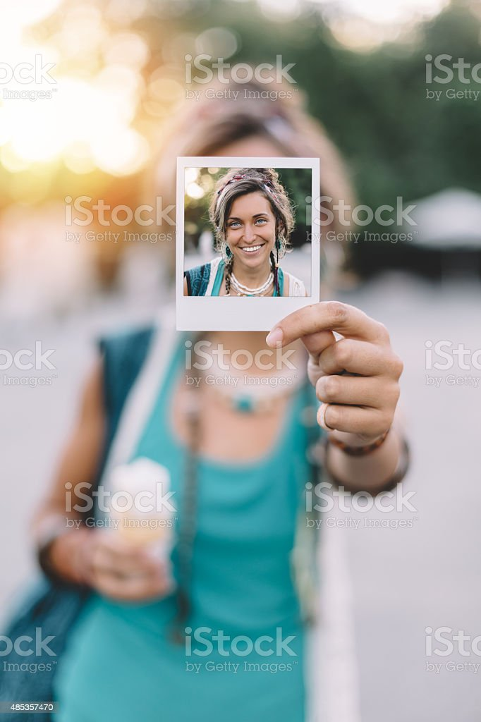 Girl holding instant photo stock photo
