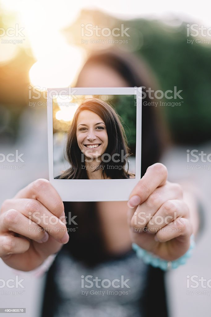 Girl holding instant photo selfie stock photo