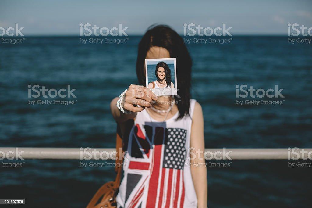 Girl holding instant photo selfie stock photo