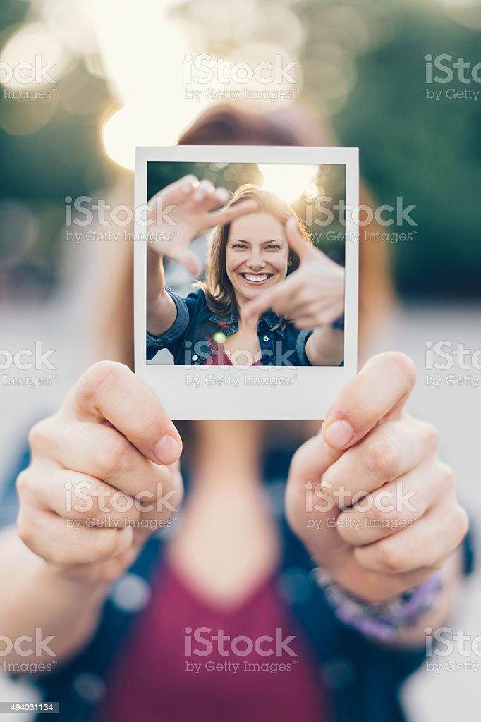Girl holding instant selfie stock photo