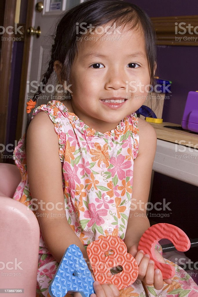 Girl holding Letters A, B, and C royalty-free stock photo
