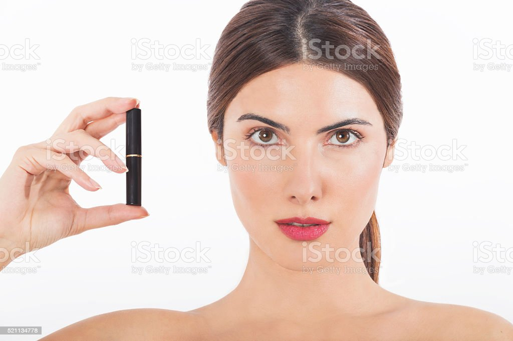 Girl holding lipstick stock photo