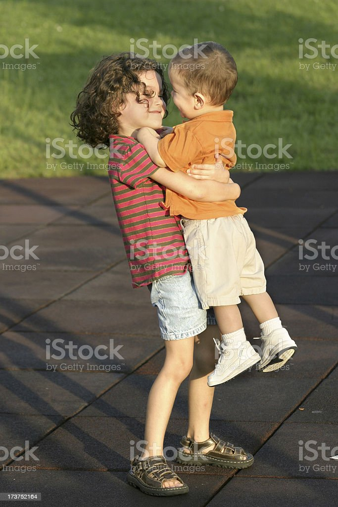 Girl Holding Little Boy - Brother and Sister royalty-free stock photo