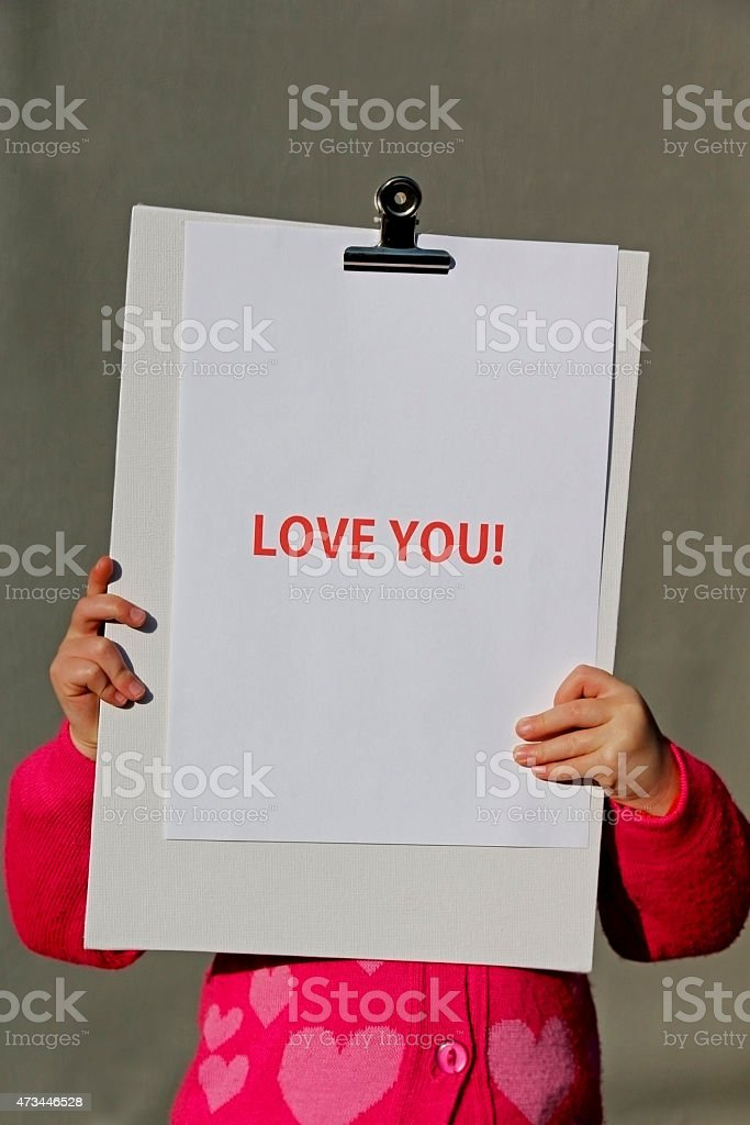 Girl holding Love you sign stock photo