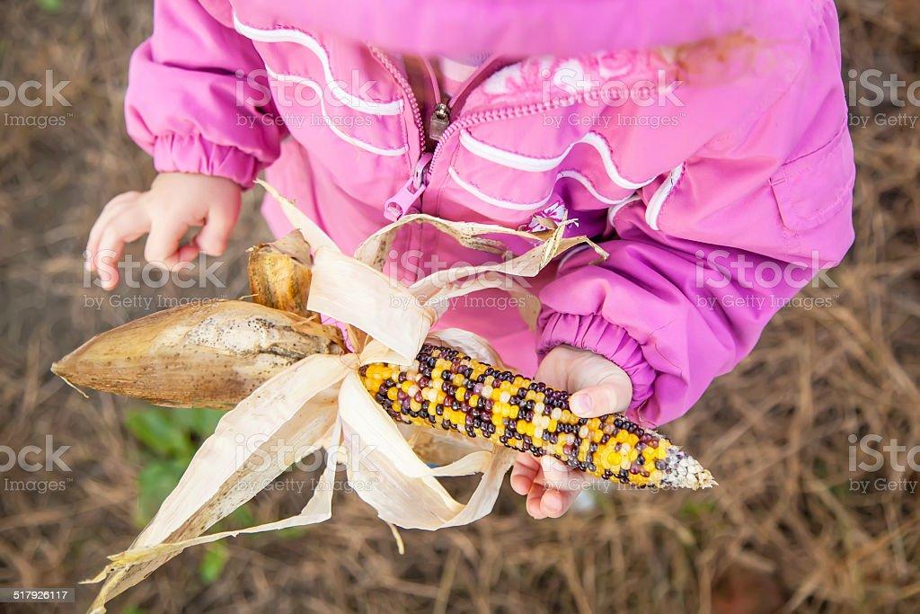 Girl Holding Multicolored Popcorn stock photo