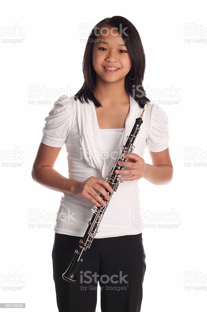 Girl holding oboe and smiling stock photo
