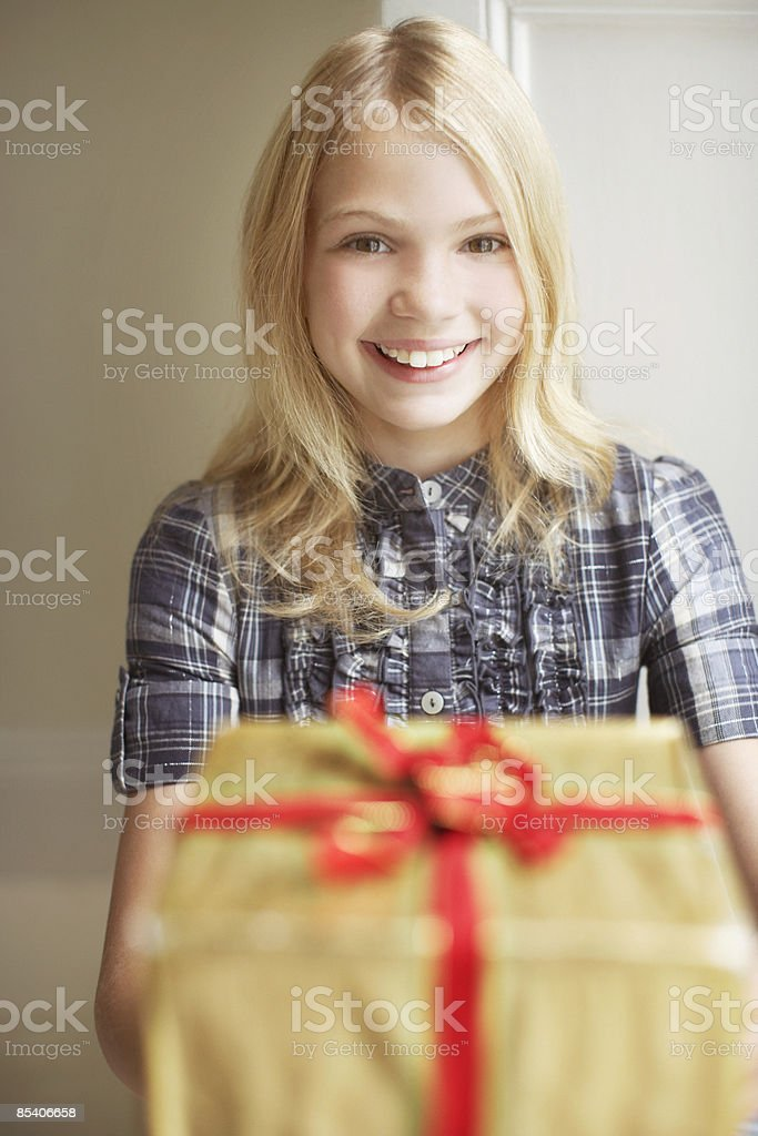 Girl holding out Christmas gift royalty-free stock photo
