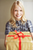 Girl holding out Christmas gift