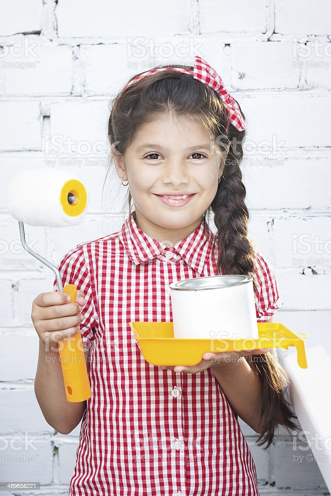 girl holding paint roller and can royalty-free stock photo