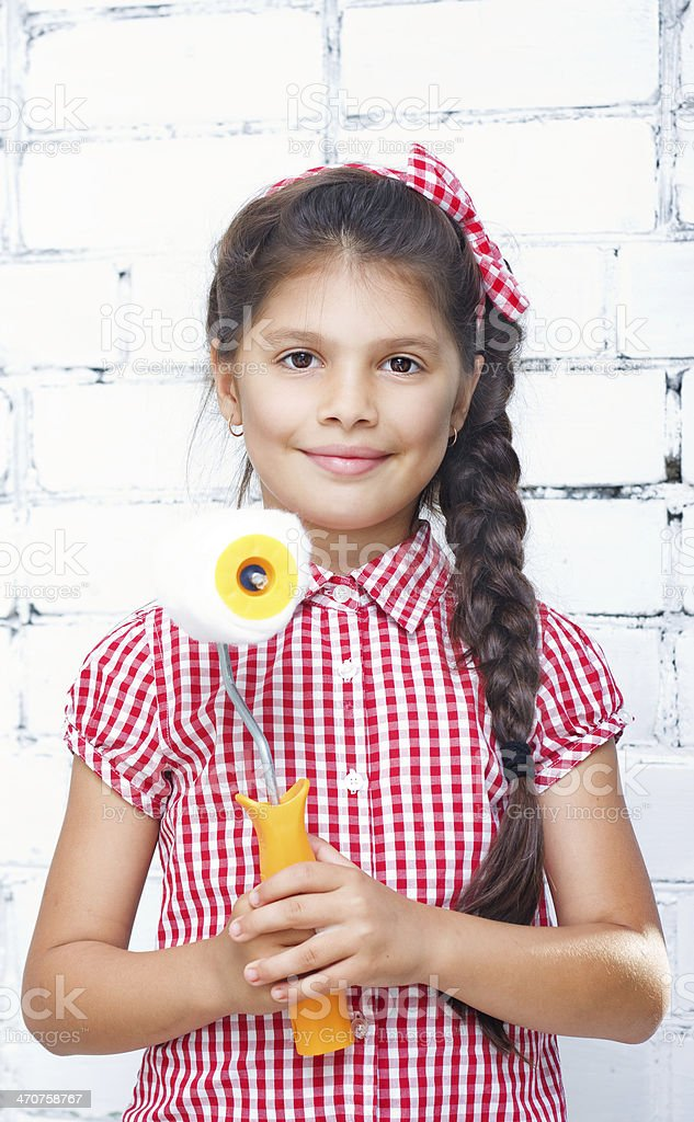 girl holding paint roller royalty-free stock photo
