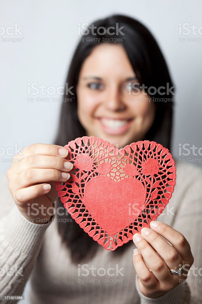 Girl holding paper heart royalty-free stock photo