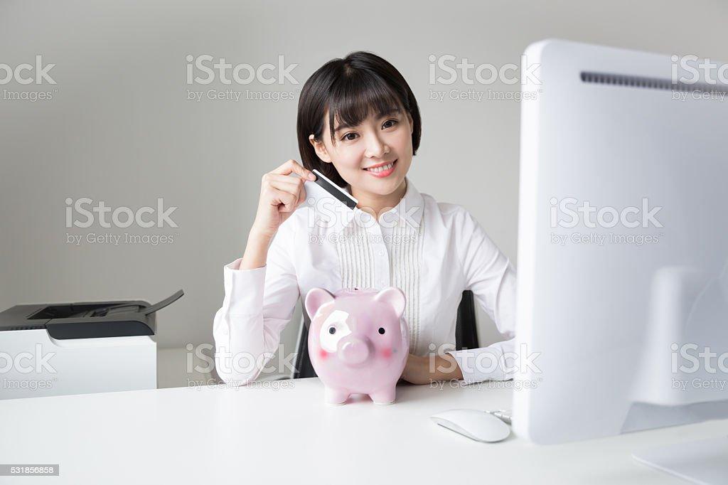girl holding piggy bank stock photo