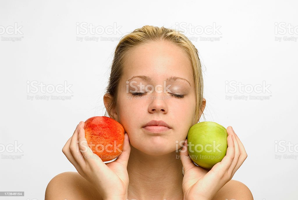 girl holding red and green apples royalty-free stock photo