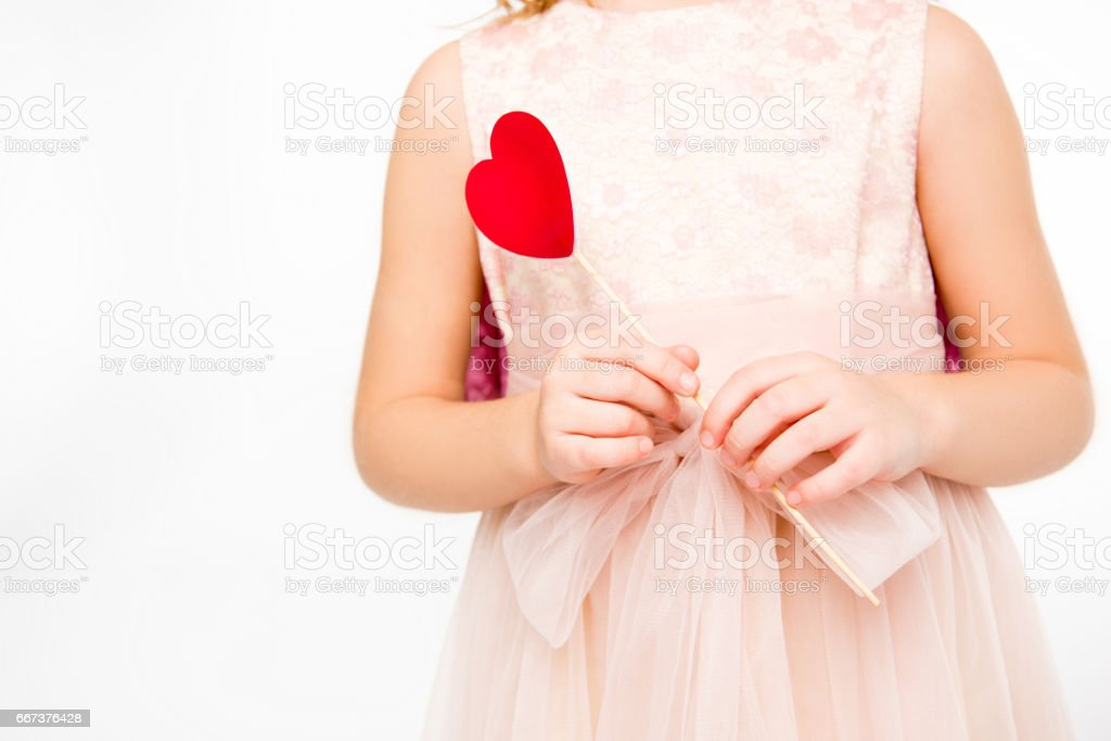 Girl holding red heart stock photo