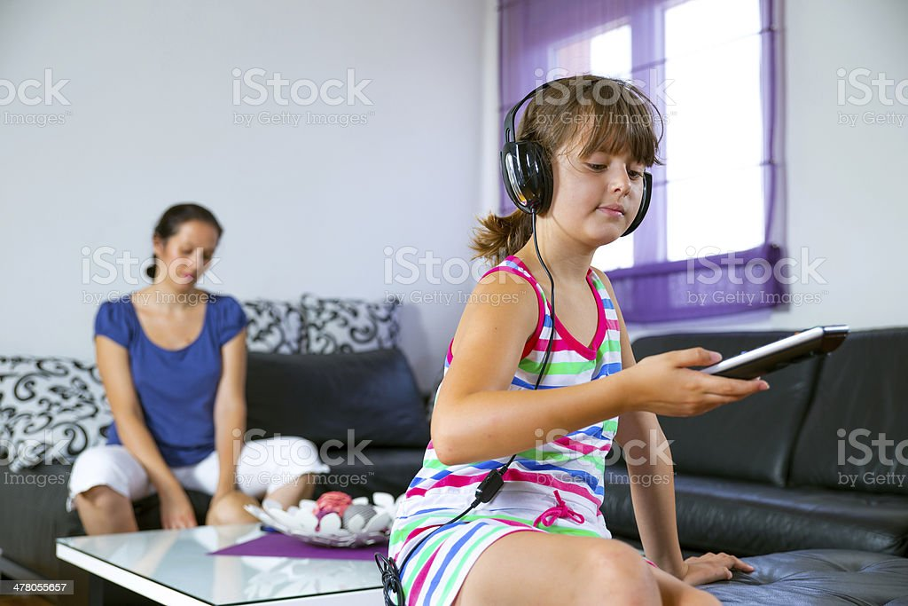 Girl holding remote control royalty-free stock photo