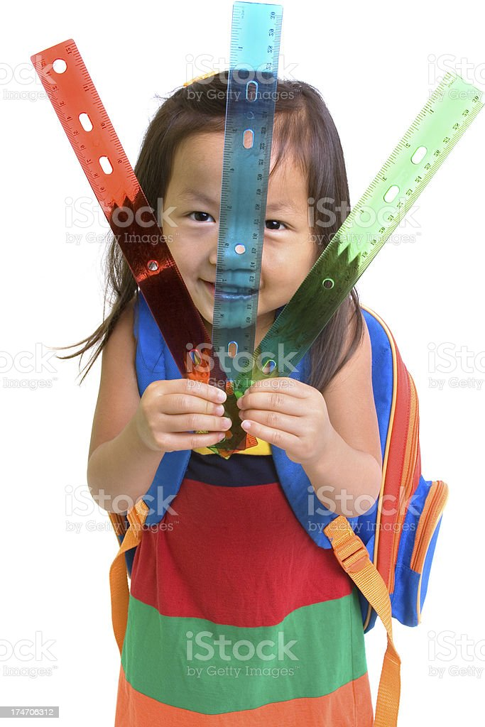 Girl holding rules royalty-free stock photo