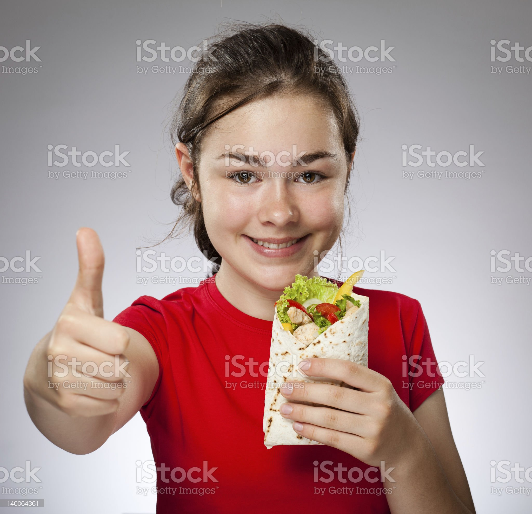 Girl holding sandwiches royalty-free stock photo