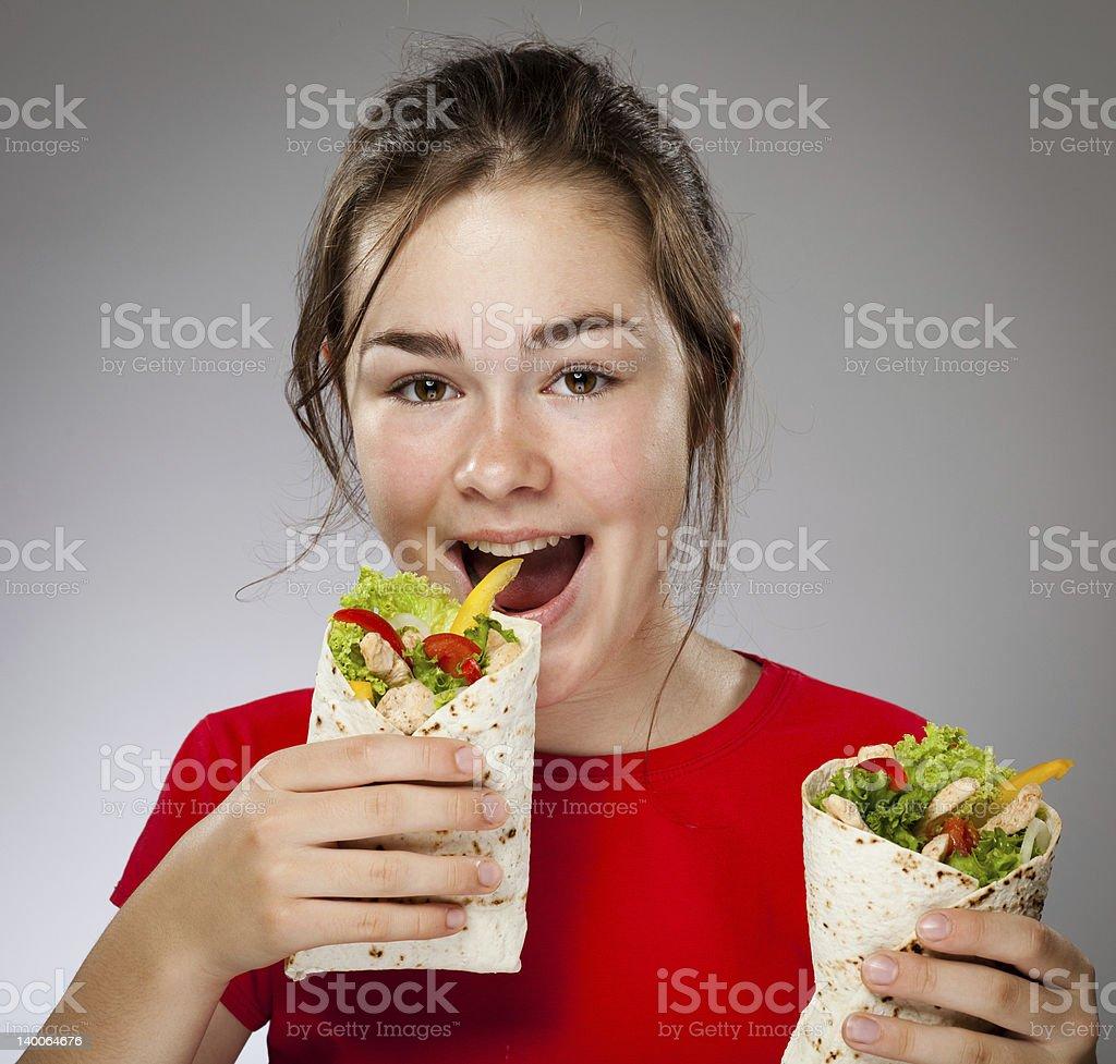 Girl holding sandwiches stock photo