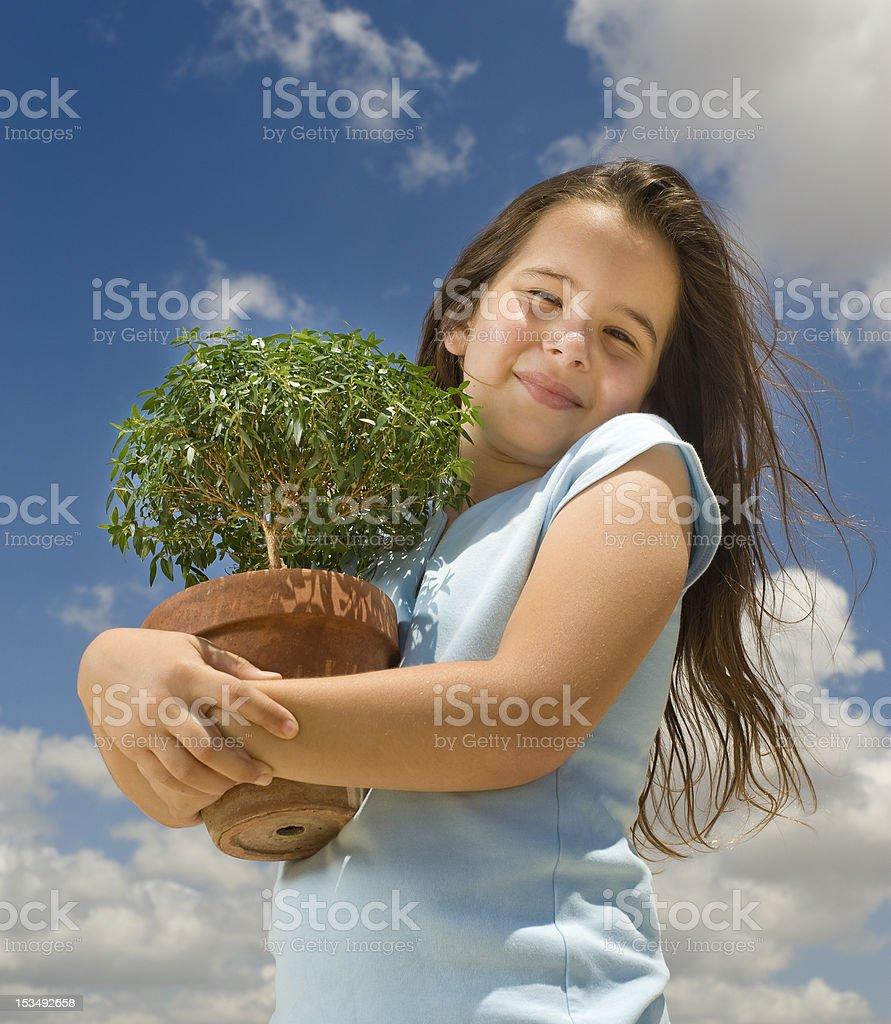 girl holding small tree royalty-free stock photo