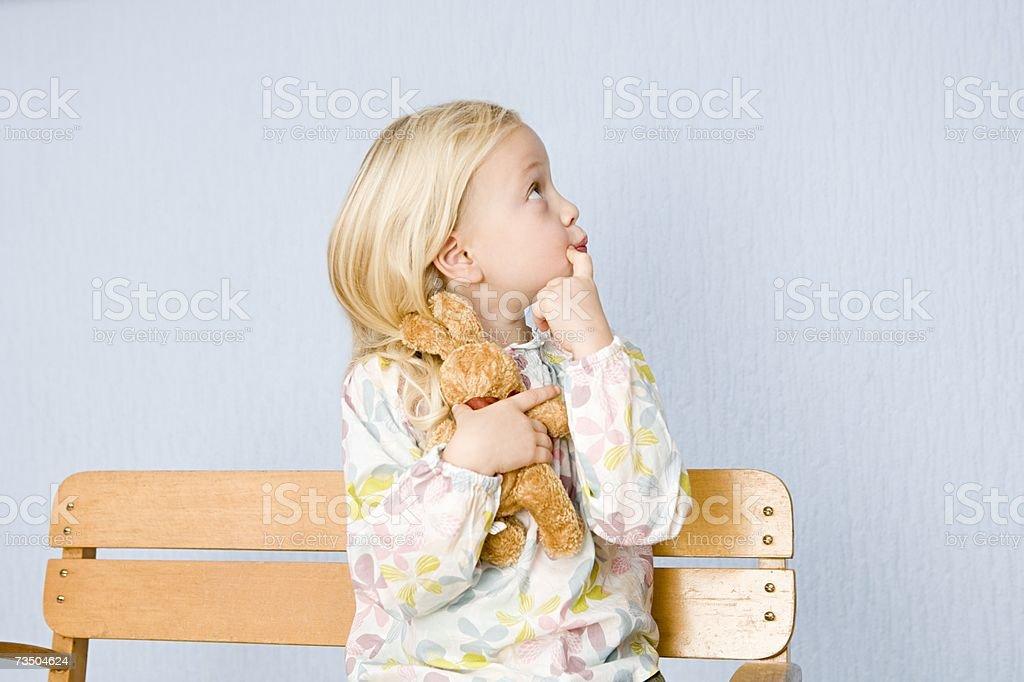 Girl holding soft toy stock photo