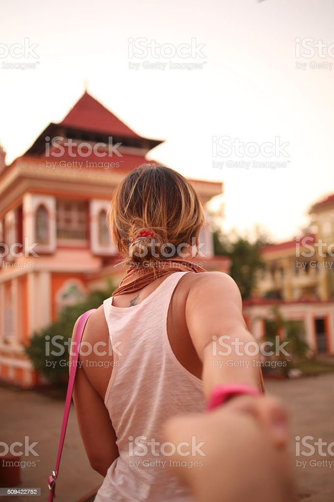 Girl holding someones hands and walking. Follow me stock photo