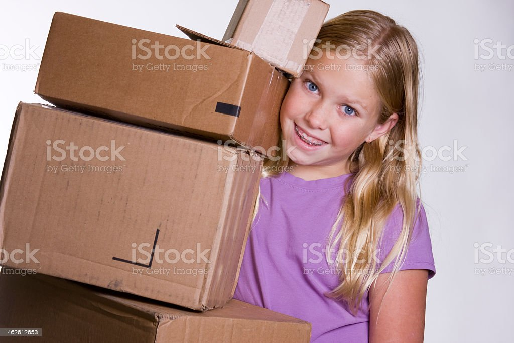 Girl Holding Stack of Boxes royalty-free stock photo