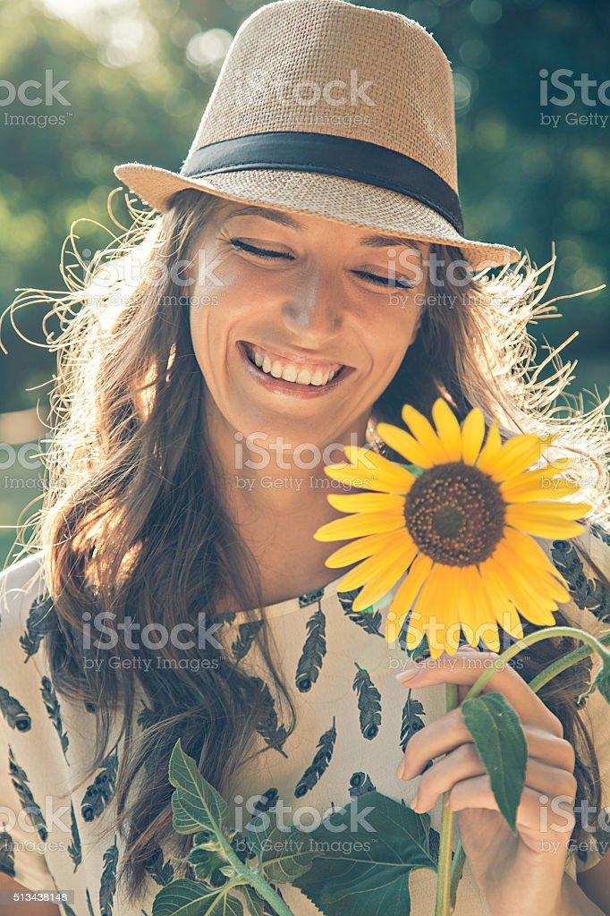 Girl holding sunflower stock photo