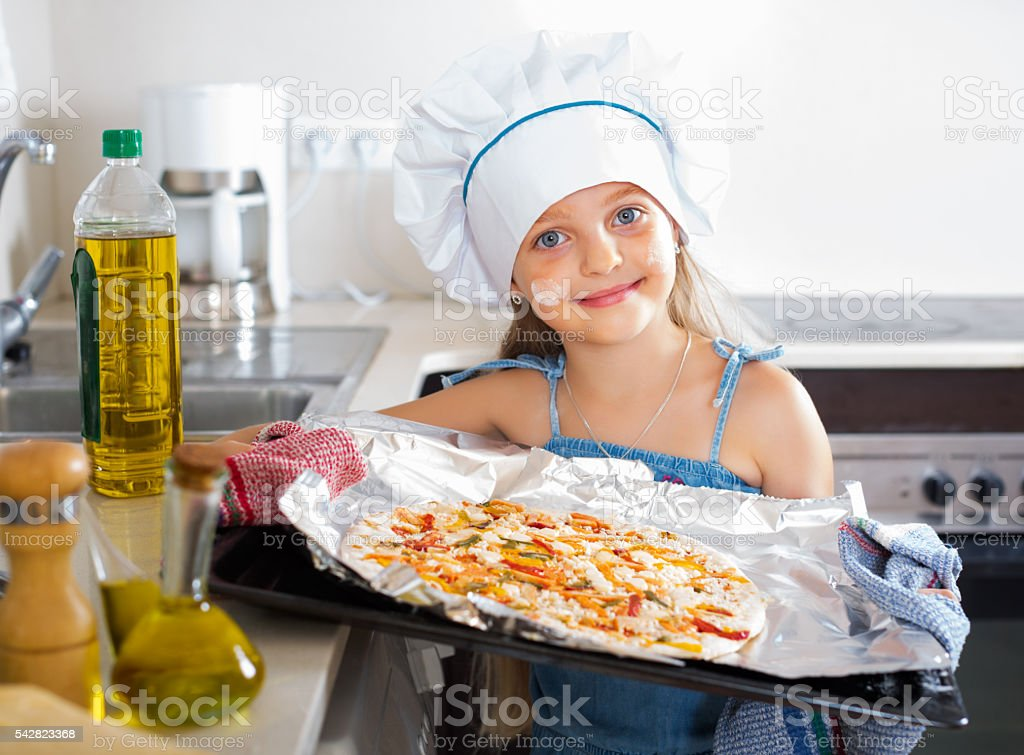 Girl holding tray with pizza stock photo