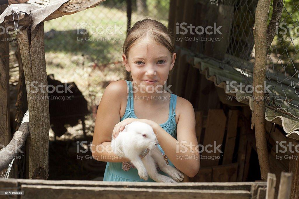 girl holding white rabbit stock photo