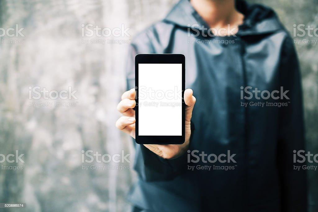 Girl holding white smartphone stock photo