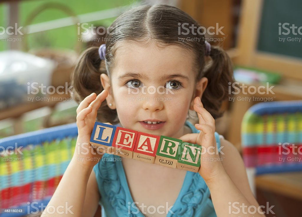 Girl holding word learn royalty-free stock photo