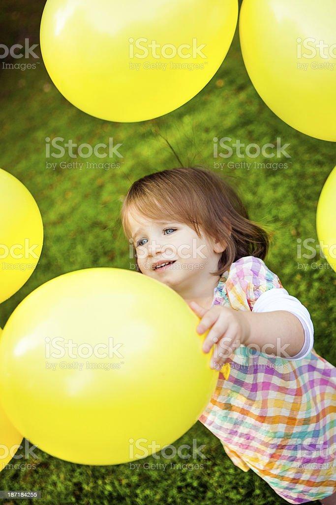 Girl Holding Yellow Balloon royalty-free stock photo