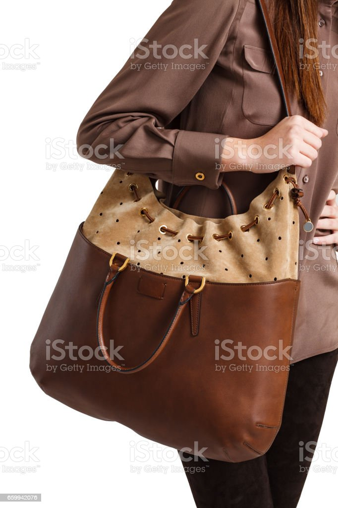Girl holds a brown bag close-up on an isolated white background stock photo