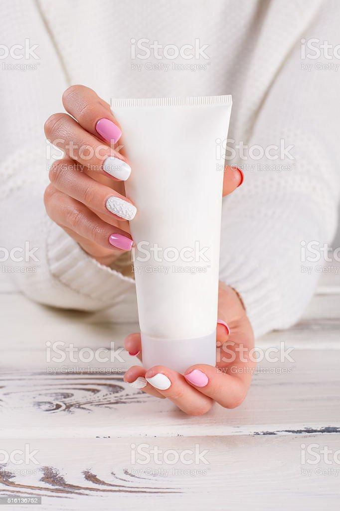 Girl holds a hand cream. stock photo